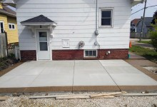 """Exposed aggregate 16"""" border with white concrete center. Checkerboard broom finish"""