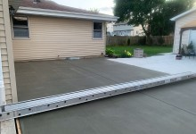 Concrete patio with bridge for safe worker access in Mt. Pleasant, WI