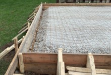 Concrete garage slab preparation - ready to pour sub-grade with wire mesh and rebar in Kenosha, WI