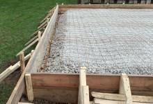 Concrete garage slab preparation - ready to pour sub-grade with wire mesh and rebar - Kenosha, WI