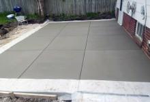 """Patio - exposed aggregate 16"""" border with white concrete center. Checkerboard broom finish"""