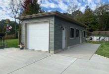 14' x 35' Detached 1 Car Garage with hip roof system, steel siding, 9' walls, and poured wall foundation